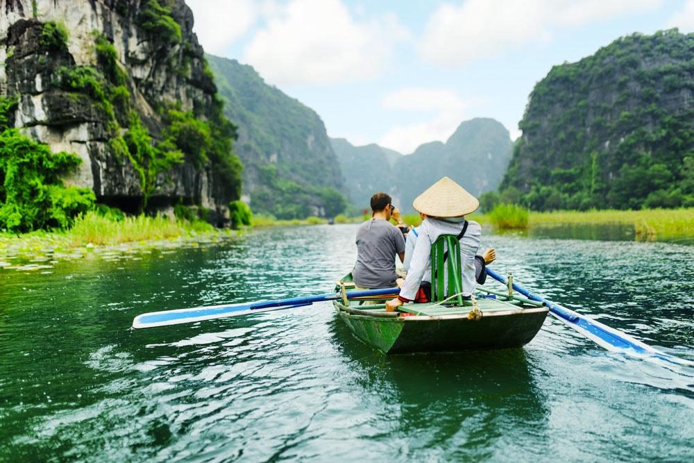 enjoying-tam-coc-boat-tour-on-tam-coc-river