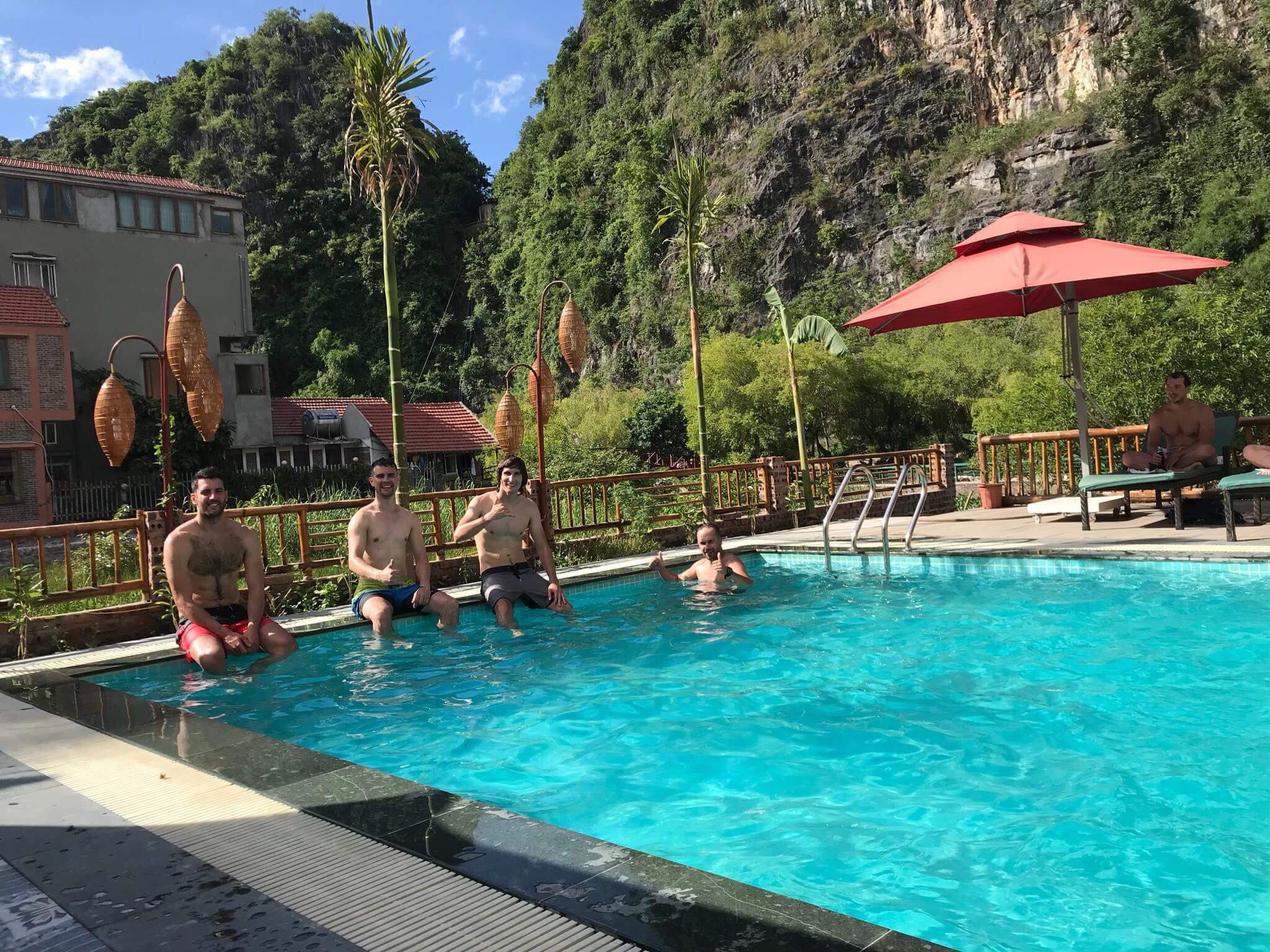 relaxing-on-swiming-pool-after-finish-tam-coc-mua-cave-tour