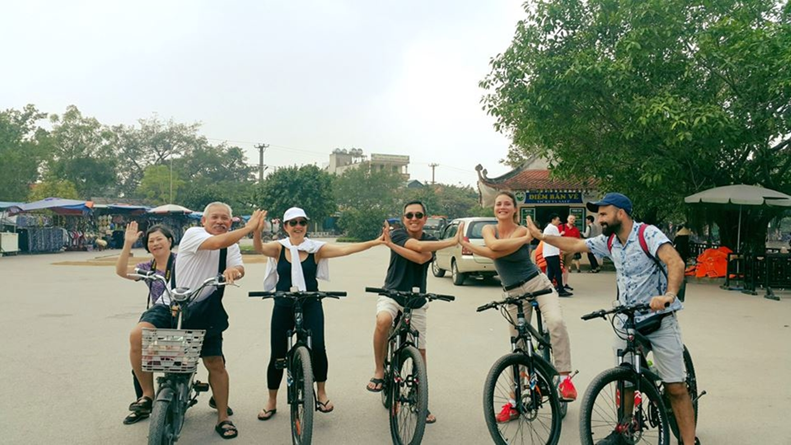 A group-is-doing-tam-coc-bike-tour-with-Hanoi-Explore-Travel